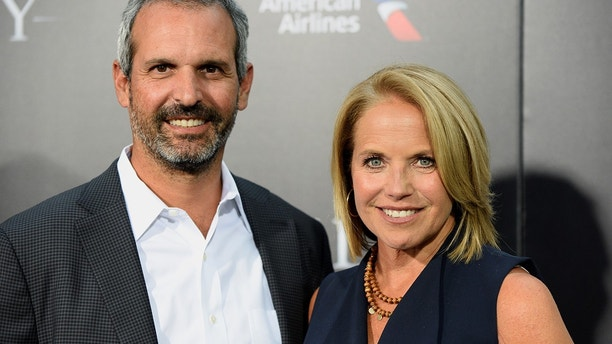 """Katie Couric and husband John Molner attend the New York premiere of the film """"Sully"""" in Manhattan, New York, U.S., September 6, 2016."""
