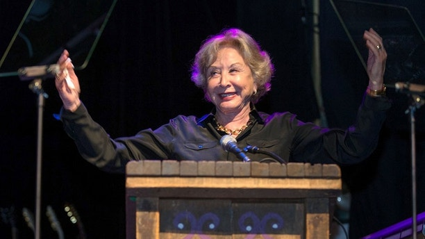 Actress Michael Learned receives the Millie Taylor award during the 2nd Annual Heroes Helping Heroes Benefit Concert at The House of Blues on Wednesday, Sept. 11, 2013 in Los Angeles. (Photo by Paul A. Hebert/Invision/AP)