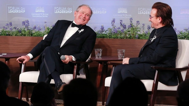 Former President George W. Bush, left, and U2 musician Bono participate in a Q&A session during a gala for the Forum on Leadership at the George W. Bush Institute, Thursday, April 19, 2018, in Dallas. (AP Photo/Brandon Wade)