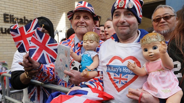 Royal fans John Loughrey, right, and Terry Hutt pose for a photo opposite the Lindo wing at St Mary's Hospital in London London, Monday, April 23, 2018.