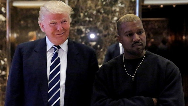 U.S. President-elect Donald Trump and musician Kanye West pose for media at  Trump Tower