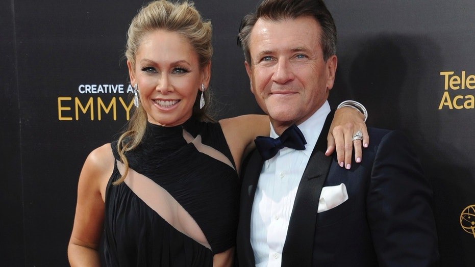 In this Sept. 11, 2016, file photo, Kym Johnson, left, and Robert Herjavec arrive at night two of the Creative Arts Emmy Awards at the Microsoft Theater in Los Angeles. Johnson and Herjavec revealed on Instagram that they welcomed twins into the world on Monday, April 23, 2018.