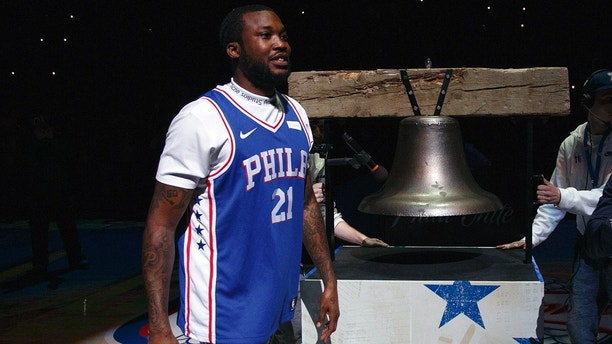 CORRECTS TO MEEK MILL NOT MEEK MILLS Rapper Meek Mill comes out to ring a Liberty Bell replica before the first half in Game 5 of a first-round NBA basketball playoff series between the Miami Heat and the Philadelphia 76ers, Tuesday, April 24, 2018, in Philadelphia. (AP Photo/Chris Szagola)