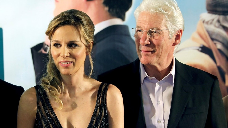 """Actor Richard Gere and his girlfriend Alejandra Silva arrive to attend premiere screening of the film """"Norman: The Moderate Rise And Tragic Fall Of A New York Fixer"""" at the Jerusalem Cinematheque, in Jerusalem March 8, 2017."""