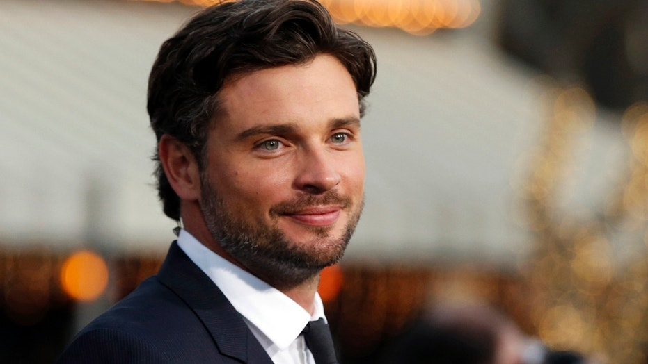 """Tom Welling poses at the premiere of """"Draft Day"""" in Los Angeles, on an April 2014 file photo."""