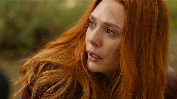 """This image released by Disney shows Elizabeth Olsen in a scene from Marvel Studios' """"Avengers: Infinity War."""""""
