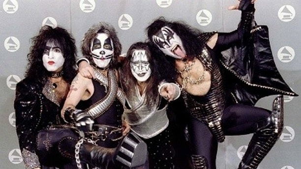 """Members of the band """"Kiss,"""" Paul Stanley (L), Peter Criss, Ace Frehley and Gene Simmons pose for photograpers backstage at the 38th Annual Grammy Awards, February 28 in Los Angeles - PBEAHUMTCBP"""
