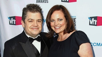 FILE - In this Jan. 12, 2012 file photo, comedian Patton Oswalt, left, and his wife Michelle McNamara arrive at the 17th annual Critics' Choice Movie Awards in Los Angeles. Patton Oswalt is crediting his late wife for her work in pursuit of the so-called Golden State Killer. Michelle McNamara had made it her mission to find the person responsible for at least 12 murders and 50 rapes throughout California in the 1970s and 80s. She died in April 2016. On Wednesday, April 25, 2018, authorities said a DNA match led them to arrest Joseph James DeAngelo, a 72-year-old former police officer, as a suspect. (AP Photo/Matt Sayles, File)