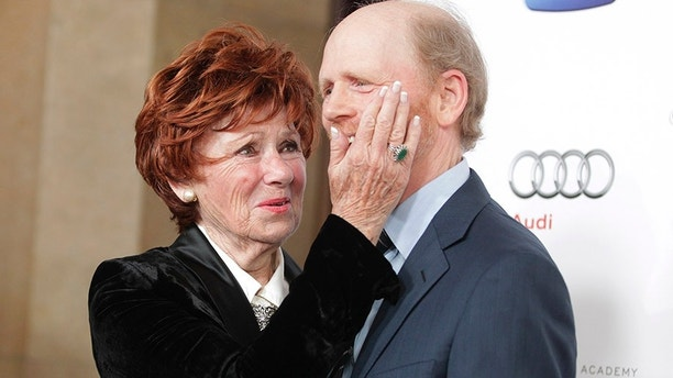 """Director and actor Ron Howard,Hall of Fame inductee, poses with his former TV co-star Marion Ross from their series """"Happy Days"""" at the Academy of Television Arts & Sciences 22nd annual Hall of Fame gala in Beverly Hills, California March 11, 2013. REUTERS/Fred Prouser (UNITED STATES - Tags: ENTERTAINMENT) - GM1E93C0X1R01"""