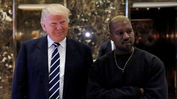 U.S. President-elect Donald Trump and musician Kanye West pose for media at Trump Tower in Manhattan, New York City, U.S., December 13, 2016.  REUTERS/Andrew Kelly - RC19E818F8C0