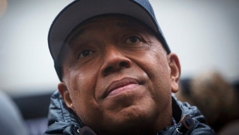 Russell Simmons speaks at a news conference along with members of Justice League NYC to present a list of demands at City Hall in New York December 10, 2014.