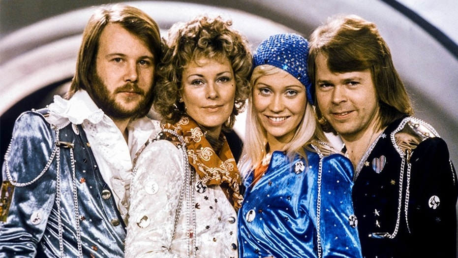 """Swedish pop group ABBA: Benny Andersson, Anni-Frid Lyngstad, Agnetha Faltskog and Bjorn Ulvaeus pose after winning the Swedish branch of the Eurovision Song Contest with their song """"Waterloo"""", February 9, 1974."""