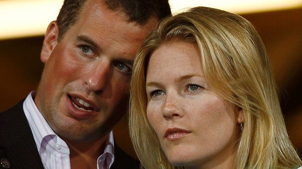 Peter Phillips, the eldest grandson of Queen Elizabeth II, speaks to his wife Autumn Kelly as they watch the equestrian individual championship test grade 1b at the Beijing 2008 Paralympic Games in Hong Kong September 9, 2008.   REUTERS/Bobby Yip   (CHINA) - GM1E4991TNY01