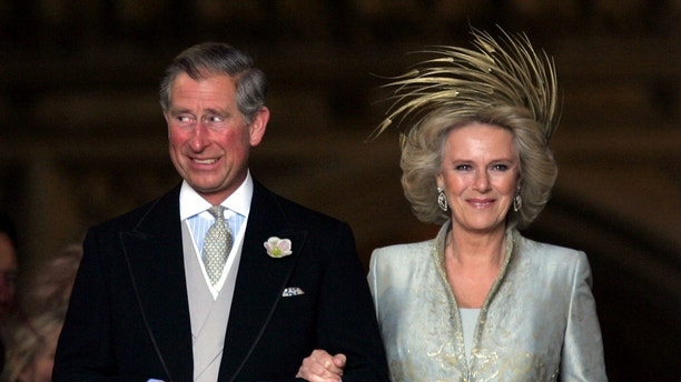 Britain's Prince Charles grins next to the Duchess of Cornwall as they leave St. George's Chapel in Windsor Castle, southern England, after the Service of Prayer and Dedication following their marriage, April 9, 2005. Prince Charles and his long-term partner Camilla Parker Bowles, who became Her Royal Highness the Duchess of Cornwall on their marriage, married on Saturday in a low-key ceremony. Pictures of the Month April 2005 REUTERS/Toby Melville PICTURES OF THE YEAR 2005  TM/CRB/SM - RP6DRNAUQCAA