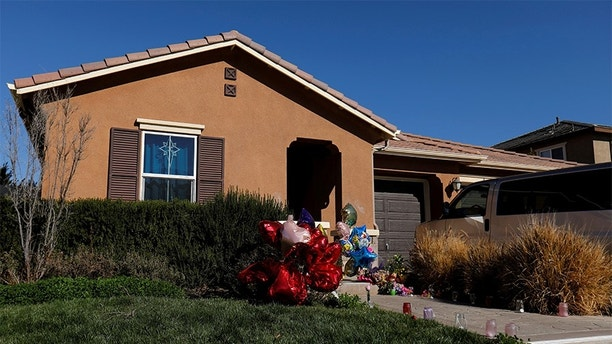 Balloons, stuffed animals and flowers are seen in the front yard of the home of David Allen and Louise Anna Turpin in Perris, California, U.S.,January 24, 2018.  REUTERS/Mike Blake - RC1C7D5D4630