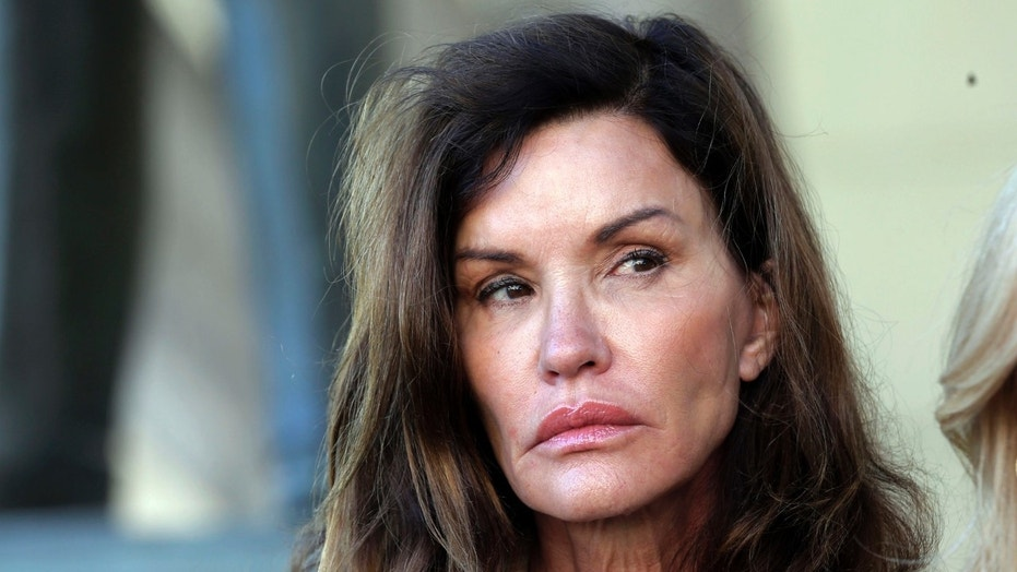 FILE - In a Tuesday, March 29, 2016 file photo, model Janice Dickinson appears outside Los Angeles Superior Court after a judge ruled her defamation lawsuit against Bill Cosby will move forward. Dickinson, a model and reality TV star, says Cosby knocked her out with a pill and raped her in Lake Tahoe in 1982, when she was 27 and Cosby was 45.  (AP Photo/Nick Ut, File)