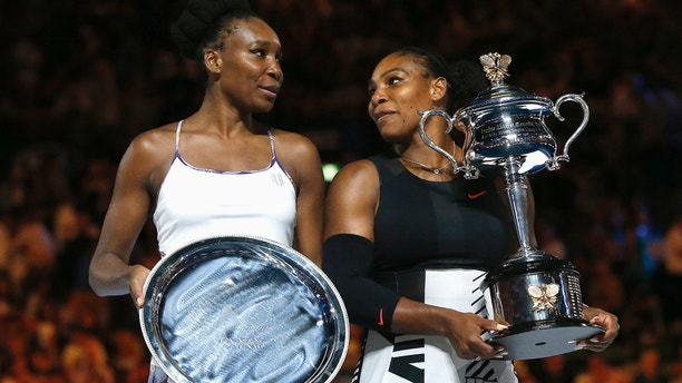 Tennis - Australian Open - Melbourne Park, Melbourne, Australia - 28/1/17 Serena Williams of the U.S. holds her trophy after winning her Women's singles final match against Venus Williams of the U.S. .REUTERS/Issei Kato   TPX IMAGES OF THE DAY - SR1ED1S0SS9EV