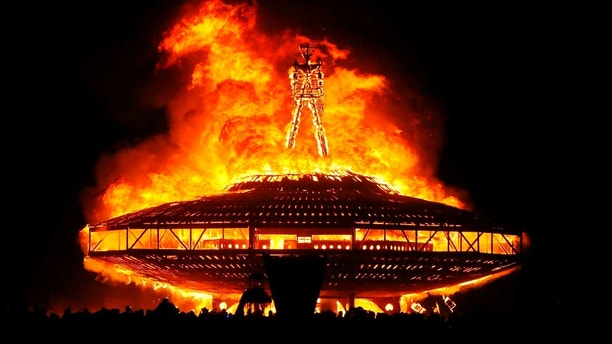 """FILE - In this Aug. 31, 2013, file photo, the """"Man"""" burns on the Black Rock Desert at Burning Man near Gerlach, Nev. Larry Harvey, the co-founder of the """"Burning Man"""" festival has died. He was 70. Burning Man Project CEO Marian Goodell says Harvey died Saturday, April 28, 2018, morning at a hospital in San Francisco. The cause was not immediately known but he had suffered a stroke on April 4. Harvey created Burning Man on a San Francisco beach in 1986, later moving the annual event to Nevada's Black Rock Desert. (Andy Barron /The Reno Gazette-Journal via AP, File)"""