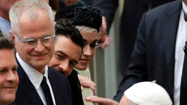 "Katy Perry, top, and Orlando Bloom, center, look at Pope Francis greeting people at the end of an audience for the participants in the ""United to Cure"" international conference on the cure for cancer in the Paul VI hall, at the Vatican, Saturday, April 28, 2018. (AP Photo/Alessandra Tarantino)"