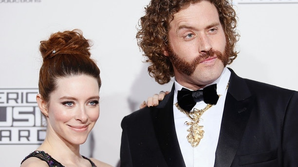 Actor T.J. Miller (R) and his wife Kate Gorney at the 2016 American Music Awards in Los Angeles, California, U.S., November 20, 2016.