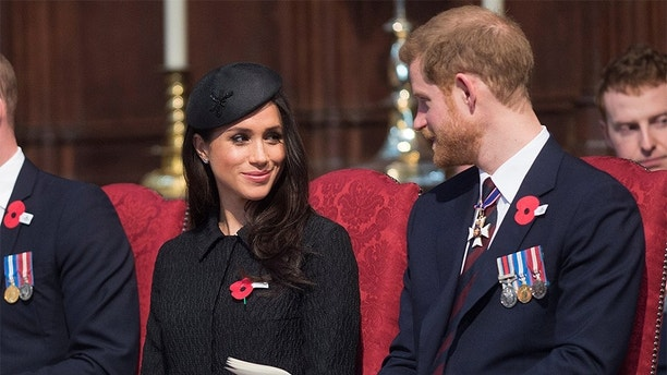 Britain's Prince Harry and his fiancee Meghan Markle attend a Service of Thanksgiving and Commemoration on ANZAC Day at Westminster Abbey in London, Britain, April 25, 2018. Eddie Mulholland/Pool via Reuters - RC12F7955700