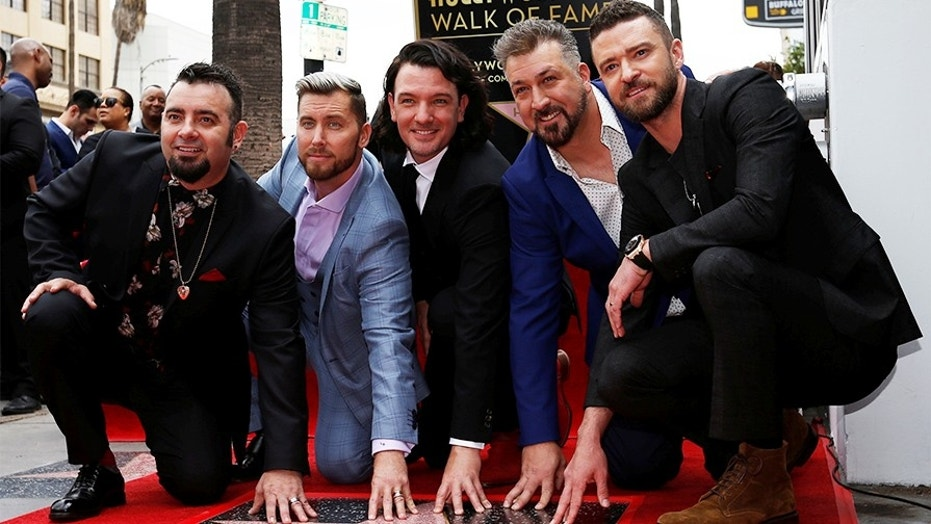 Justin Timberlake (right), who recently received a star on Hollywood's Walk of Fame alongside his *NSYNC bandmates, admitted he onced hooked up with a Spice Girl.