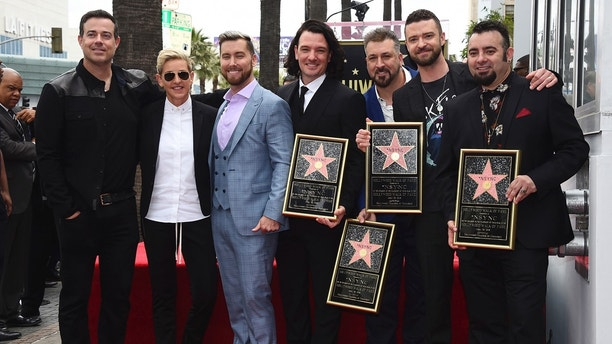 Carson Daly, from left, Ellen DeGeneres, Lance Bass, JC Chasez, Joey Fatone, Justin Timberlake and Chris Kirkpatrick attend a ceremony honoring NSYNC with a star on the Hollywood Walk of Fame on Monday, April 30, 2018, in Los Angeles. (Photo by Jordan Strauss/Invision/AP)