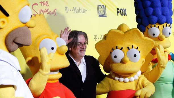 Matt Groening (C), creator of The Simpsons, poses with characters from the show (L-R) Homer, Bart, Lisa and Marge at the 20th anniversary party for the television series at Barker hangar in Santa Monica, California October 18, 2009.    REUTERS/Mario Anzuoni/File Photo - TM3ECB416DA01