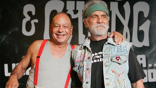 Comedians Cheech & Chong, Cheech Marin (L) and Tommy Chong, pose after announcing their first comedy tour in 25 years during a news conference in Los Angeles July 30, 2008. The counter-culture duo are famous for their comedy routines about marijuana. REUTERS/Fred Prouser (UNITED STATES) - GM1E47V0EJZ01