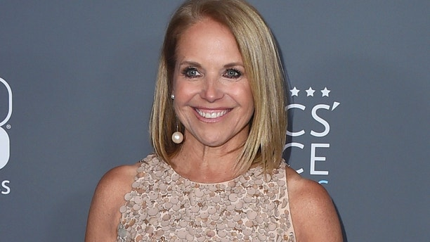 In this Jan. 11, 2018 file photo, Katie Couric poses in the press room at the 23rd annual Critics' Choice Awards in Santa Monica, Calif.  NBC is bringing back Katie Couric to co-host the opening ceremony of the Winter Olympics next month. She will be co-host with Mike Tirico, who is replacing Bob Costas as prime-time host of the games. The ceremony will take place in South Korea on Feb. 9.
