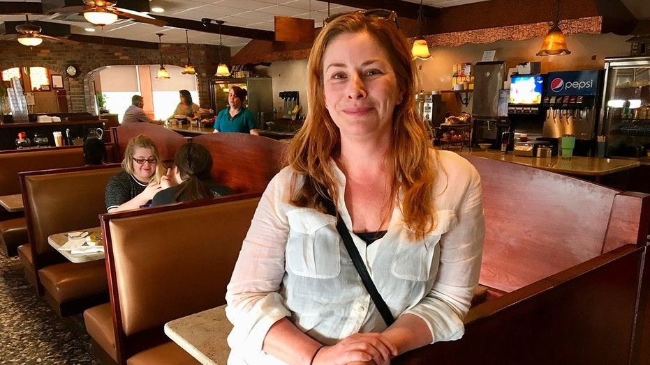 "Diane Neal poses at a diner Wednesday, May 2, 2018, during an interview in Kingston, N.Y.,  discussing her campaign for the 19th congressional district. The  former ""Law and Order"" actress  is seeking a new gig as representative of a sprawling congressional district in upstate New York.(AP Photo/Mary Esch)"