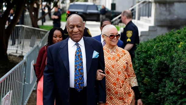 FILE - In this April 24, 2018 file photo, Bill Cosby, left, arrives with his wife, Camille, for his sexual assault trial at the Montgomery County Courthouse in Norristown, Pa. On Thursday, April 26, 2018, Cosby was convicted of drugging and molesting a woman in the first big celebrity trial of the #MeToo era, completing the spectacular late-life downfall of a comedian who broke racial barriers in Hollywood on his way to TV superstardom as America's Dad. (AP Photo/Matt Slocum, File)