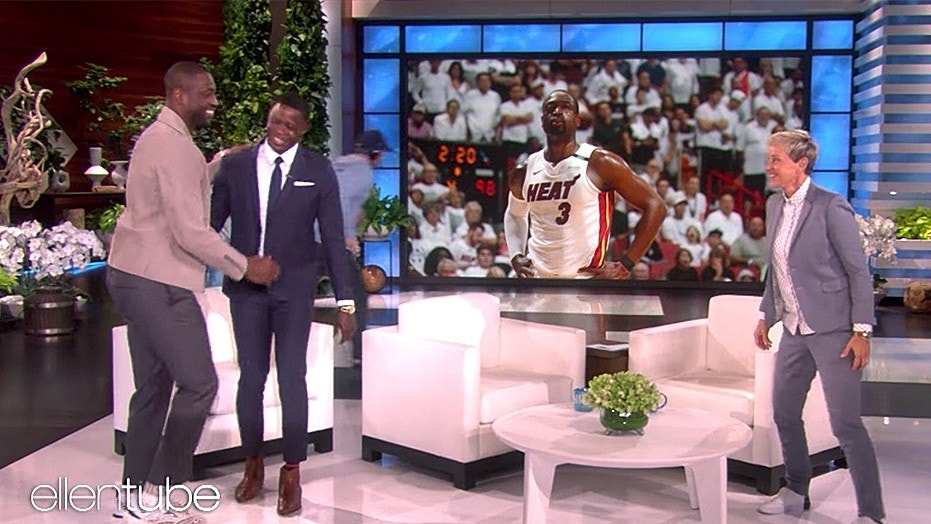 "Dwyane Wade, left, shocked James Shaw Jr. when he turned up during Shaw's ""Ellen"" appearance."