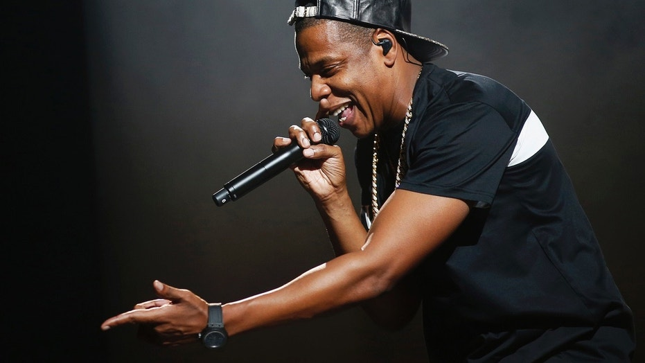 American rapper Jay-Z, pictured here performing at Bercy stadium in Paris, October 17, 2013, is in legal trouble for dodging a subpoena.