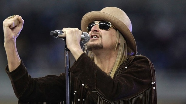 FILE - This Nov. 25, 2010 file photo shows musician Kid Rock performing during the  half time ceremony at the NFL football game between the Detroit Lions and the New England Patriots at Ford Field in Detroit. The Detroit NAACP is giving their Great Expectations Award to Kid Rock for his advocacy of the city, drawing some criticism because the Grammy-nominated artist has used the Confederate flag during stage performances.  (AP Photo/Carlos Osorio, File)