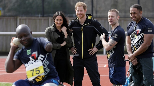 Britain's Prince Harry, Patron of the Invictus Games Foundation, and Meghan Markle meet athletes at the team trials for the Invictus Games Sydney 2018 at the University of Bath Sports Training Village in Bath, Britain, April 6, 2018. Kirsty Wigglesworth/Pool via Reuters - RC142D310D00