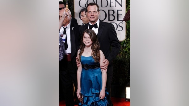 Bill Paxton and his daughter Lydia Paxton arrive at the 67th Annual Golden Globe Awards on Saturday, Jan. 17, 2010, in Beverly Hills, Calif. (AP Photo/Matt Sayles)