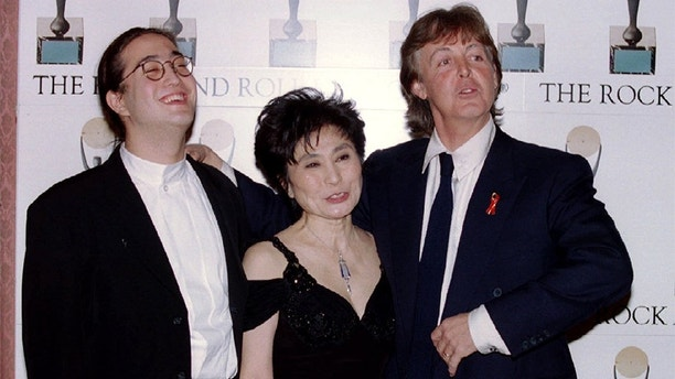 Former Beatle Paul McCartney R Laughs With Yoko Ono And Sean Lennon After Inducting