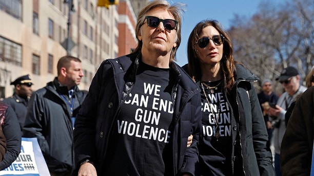 """Former Beatle Sir Paul McCartney joins the rally during a """"March For Our Lives"""" demonstration demanding gun control in New York City, U.S. March 24, 2018. REUTERS/Shannon Stapleton - HP1EE3O173GC0"""
