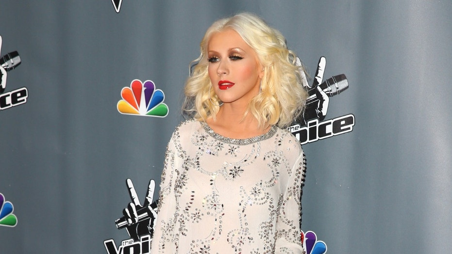 "Christina Aguilera arrives to the ""The Voice"" Season 5 Top 12 Event at Universal Studios Hollywood on November 7, 2013 in Universal City, California."