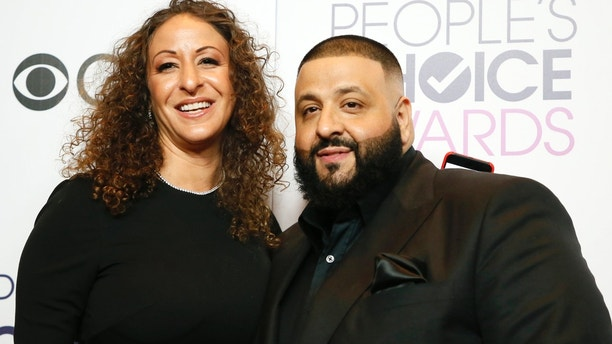 DJ Khaled and wife Nicole pose backstage at the People's Choice Awards 2017 in Los Angeles, California, U.S., January 18, 2017.  REUTERS/Danny Moloshok - HT1ED1J0FHFHT
