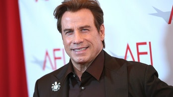 FILE - In this Jan. 6, 2017 file photo, John Travolta arrives at the AFI Awards at the Four Seasons Hotel on in Los Angeles. Travolta will be the recipient of Variety's inaugural Cinema Icon Award on May 15, 2018, at the Cannes Film Festival. (Photo by Chris Pizzello/Invision/AP, File)
