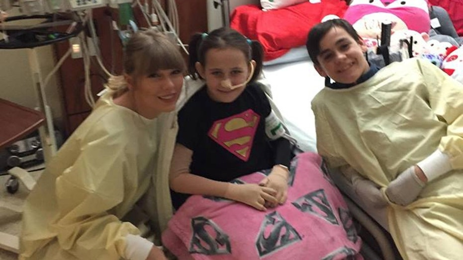Taylor Swift visited a young fan recovering from severe burns.