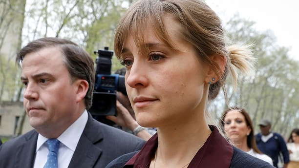 Actor Allison Mack, known for her role in the TV series 'Smallville', exits with her lawyer following a hearing on charges of sex trafficking in relation to the Albany-based organization Nxivm at United States Federal Courthouse in Brooklyn, New York, U.S., May 4, 2018. REUTERS/Brendan McDermid - RC125DF6B940
