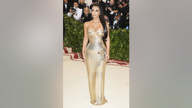 "Kim Kardashian arrives at the Metropolitan Museum of Art Costume Institute Gala (Met Gala) to celebrate the opening of ""Heavenly Bodies: Fashion and the Catholic Imagination"" in the Manhattan borough of New York, U.S., May 7, 2018. REUTERS/Carlo Allegri - HP1EE5802579L"