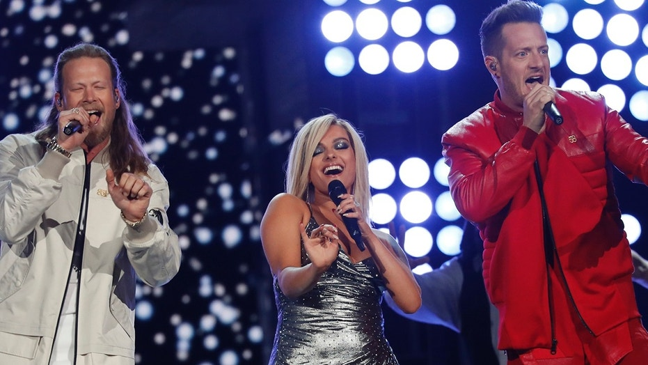 Bebe Rexha (center), pictured here performing with country duo Florida Georgia Line, is among several pop singers who are up for an award at the CMT Awards in June.