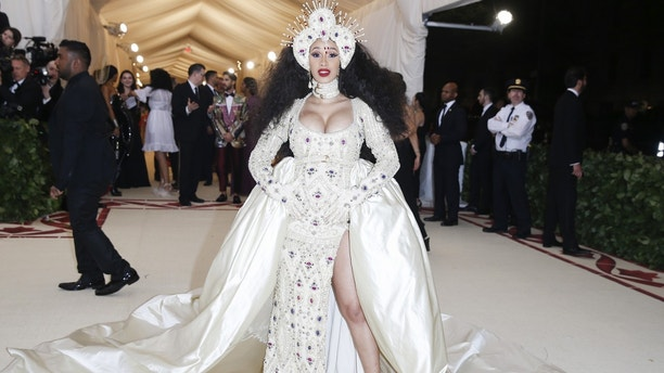 """Rapper Cardi B arrives at the Metropolitan Museum of Art Costume Institute Gala (Met Gala) to celebrate the opening of """"Heavenly Bodies: Fashion and the Catholic Imagination"""" in the Manhattan borough of New York, U.S., May 7, 2018. REUTERS/Carlo Allegri - HP1EE5802GMAN"""
