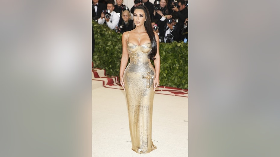 Kim Kardashian poses sans Kanye West at the Metropolitan Museum of Art Costume Institute Gala.