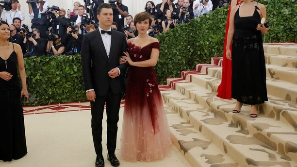 """Scarlett Johansson and Colin Jost arrive at the Metropolitan Museum of Art Costume Institute Gala (Met Gala) to celebrate the opening of """"Heavenly Bodies: Fashion and the Catholic Imagination"""" in the Manhattan borough of New York, U.S., May 7, 2018. REUTERS/Eduardo Munoz - HP1EE5804BRG7"""