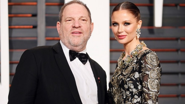 Producer Harvey Weinstein and wife, designer Georgina Chapman, arrive at the 2015 Vanity Fair Oscar Party in Beverly Hills, California February 22, 2015.